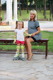 Pregnant woman and little girl royalty free stock photo