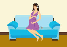 Pregnant Woman In Living Room Stock Images