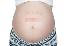 Pregnant woman with loading concept painted on her belly Stock Photos