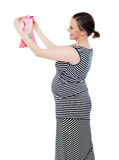 Pregnant woman looking at baby cloth, rejoicing Stock Photo