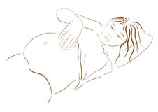 Pregnant woman looking at her belly Royalty Free Stock Image