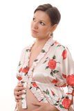 Pregnant woman looks up Royalty Free Stock Photos