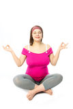 Pregnant woman in lotus pose Royalty Free Stock Photos