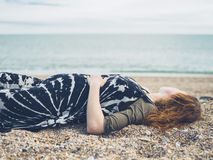 Pregnant woman lying on the beach Stock Photos