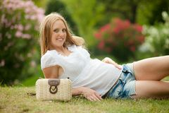 Pregnant woman lying on grass Stock Image