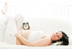 Pregnant woman lying on the sofa Royalty Free Stock Image
