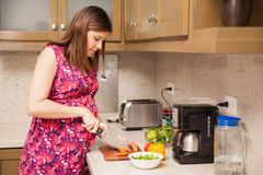 Pregnant Woman Making A Salad Stock Images