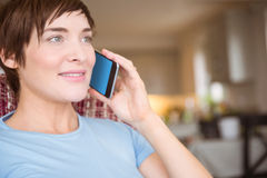 Pregnant woman making a call Stock Images