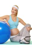 Pregnant woman making exercise Royalty Free Stock Images