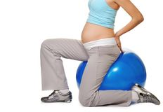 Pregnant woman making exercise Stock Photography