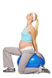 Pregnant woman making exercise Stock Photo