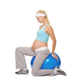 pregnant woman making exercise Stock Image