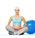 Pregnant woman making exercise Royalty Free Stock Image