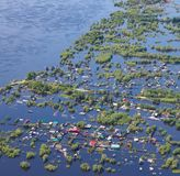 Flooded terrain in lowlend of Great river. Ob River Flood June 2015 Aerial View of same houses in vicinity of Nizhnevartovsk, Tyumen region, Russia. Aerial view stock photography