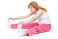 Pregnant woman making fitness Stock Photo
