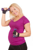 Pregnant woman making fitness exercises Stock Photo