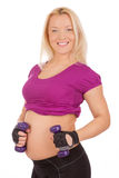 Pregnant woman making fitness exercises Stock Photography