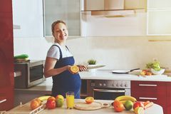 pregnant woman making healthy fruit juice Royalty Free Stock Image