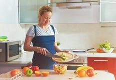 Pregnant woman making healthy fruit salad Stock Photos