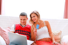 Pregnant woman making on-line purchases Royalty Free Stock Photos