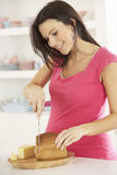 Pregnant Woman Making Sandwich In Kitchen At Home Royalty Free Stock Photos