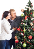 A pregnant woman and a man celebrating Christmas Royalty Free Stock Photography