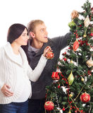 A pregnant woman and a man celebrating Christmas Stock Image