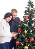 A pregnant woman and a man celebrating Christmas Stock Photo