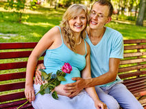 Pregnant woman with man outdoor Stock Photo