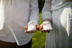 Pregnant woman and man posing at summer park. Stock Photo
