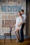 Pregnant woman and man posing together in the Studio stock images