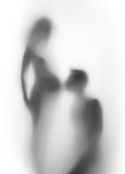 Pregnant woman and man together, silhouette Stock Images