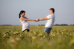 Pregnant woman and man Stock Images