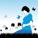 Pregnant woman in a meadow Royalty Free Stock Photo