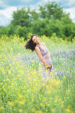 Pregnant woman in meadow Stock Photo
