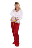 Pregnant woman measures her belly Royalty Free Stock Image