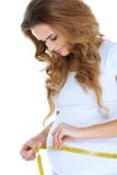 Pregnant woman measurig her belly Royalty Free Stock Photo