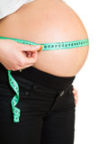 Pregnant woman measuring belly Royalty Free Stock Photography