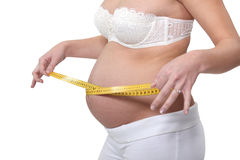 Pregnant woman measuring belly Stock Photo