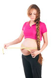 Pregnant woman is measuring her stomach Royalty Free Stock Images
