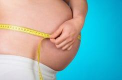 Pregnant woman measuring her stomach Stock Photos