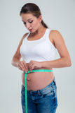 Pregnant woman measuring pregnant belly Stock Images