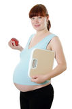 Pregnant woman with a measuring tape Royalty Free Stock Photography