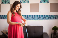 Pregnant woman measuring waist Stock Photography