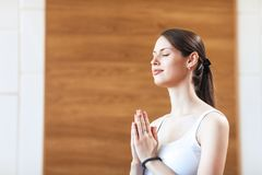 Pregnant woman meditates in yoga pose. Woman enjoying in meditation. Close up. Royalty Free Stock Images