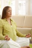 Pregnant woman meditating Royalty Free Stock Photo