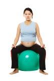 Pregnant woman meditating royalty free stock photo
