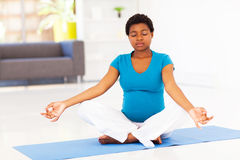 Pregnant woman meditation Stock Photo