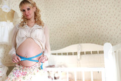 Pregnant woman mesaurment belly indoor stock images