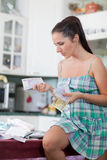Pregnant  woman with money. Family budget. Royalty Free Stock Photography